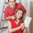 Happy Couple with Color Guide — Stockfoto #6557895