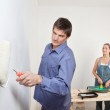 Portrait of young couple painting — Stock Photo
