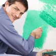 Handsome man painting house — Stock Photo