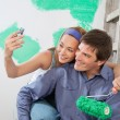 Couple taking self portraits — Stock Photo #6559049