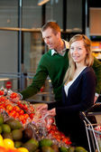 Portrait of Couple in Supermarket — Stock Photo
