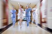 Surgeon and nurse running — Stock Photo