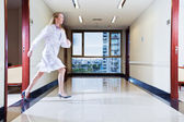 Female doctor rushing in hallway — Stock Photo