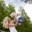 Mother Throwing Son in Air — Stock Photo #6560170