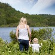 Mother and Son in Meadow — Stock Photo