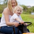 Stock Photo: Mother Driving Tractor with Son