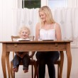 Mother and Child at Table — Stock Photo