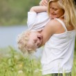 Mother and Son Playing in Meadow — Stock Photo