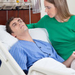 Sick patient with wife - Stock Photo