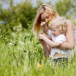 Mother and Son in Grass Field — Stock Photo