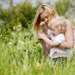 Mother and Son in Grass Field - Stock Photo