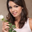 Portrait of woman holding roses — Stock Photo #6573633