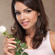 Stock Photo: Portrait of woman holding roses