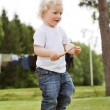 Stock Photo: Boy holding gardening tool