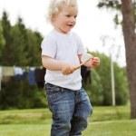 Boy holding gardening tool — Stock Photo