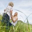 Mother and little boy in grass — Stock Photo