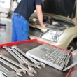 Closeup of a laptop and wrench — Stock Photo