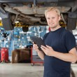 Mechanic with digital tablet - Stock Photo