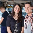 Portrait of smiling young couple in mechanic shop — Stock Photo