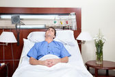 Young patient lying on bed — Stock Photo