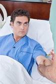Patient staring doctor — Stock Photo