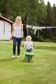 Mother and child in garden — Stock Photo