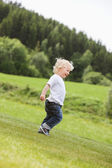 Toddler Boy Walking Alone in Garden — Stock Photo