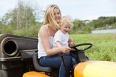 Mother and Child mowing grass — Stock Photo