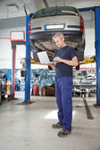 Mechanic using laptop — Stock Photo