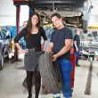 Mechanic Showing Tire to Customer — Stock Photo