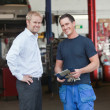 Foto Stock: Business Customer Standing With Mechanic