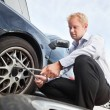 Flat Tire Business Man - Stock Photo