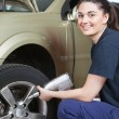 Happy Woman Mechanic Tire Change — Stockfoto