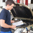Mechanic with Work Order - Stock Photo