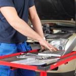 Mechanic working on a laptop — Stock Photo