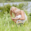 图库照片: Mother and child in grass