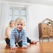 Baby crawling with mother in the background — Stock Photo #6584916