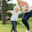 Stock Photo: Baby boy learning to walk