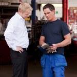 Confident Mechanic with Customer — Stock Photo