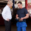 Confident Mechanic with Customer — Stock Photo