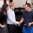 Mechanic with Happy Customer - Stock Photo