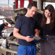 Mechanic and Customer Discussing Service Order — Foto de Stock