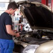 Mechanic Servicing Car — Stock Photo
