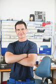 Handsome mechanic at auto repair shop — Stock Photo
