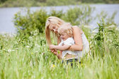 Mother and child in grass — Stock Photo