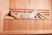 Young woman enjoying sauna — Stock Photo