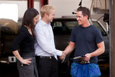 Mechanic with Happy Customer — Stock Photo
