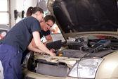 Mechanic using Digital Tablet — Stock Photo