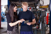 Mechanic with Upset Customer — Stock Photo