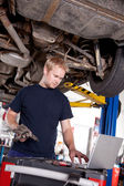 Mechanic with Laptop — Stock Photo